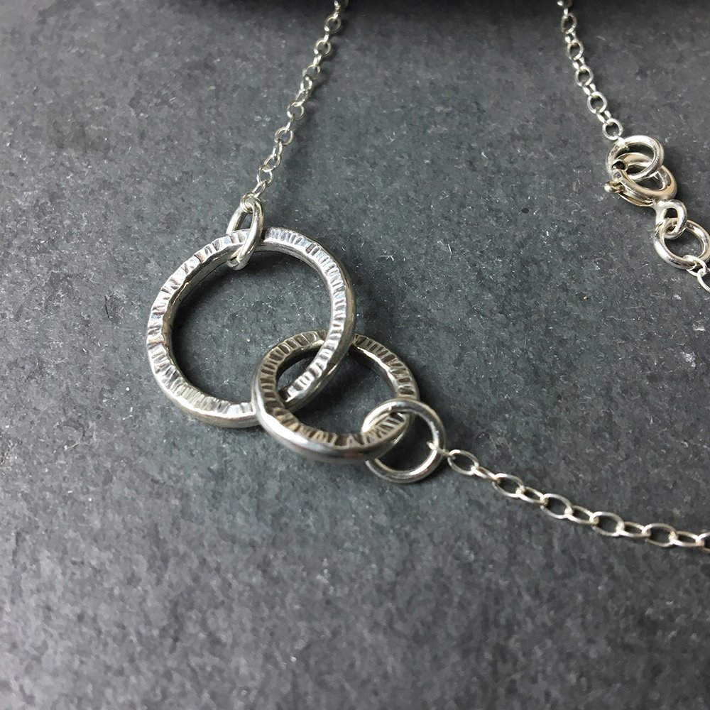 Delicate sterling silver circles hammered necklace