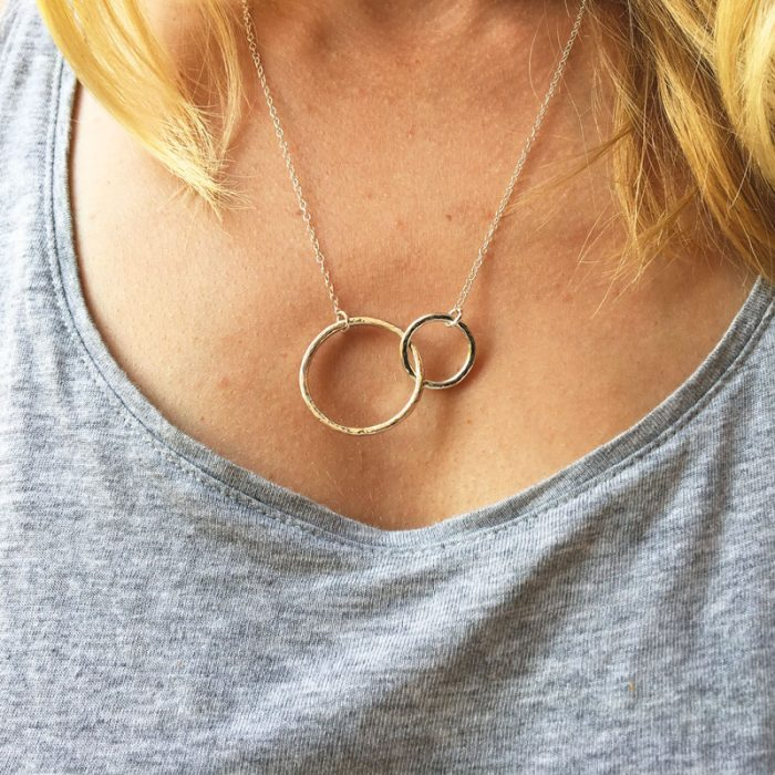 Sterling silver infinity necklace hammered jewellery on model