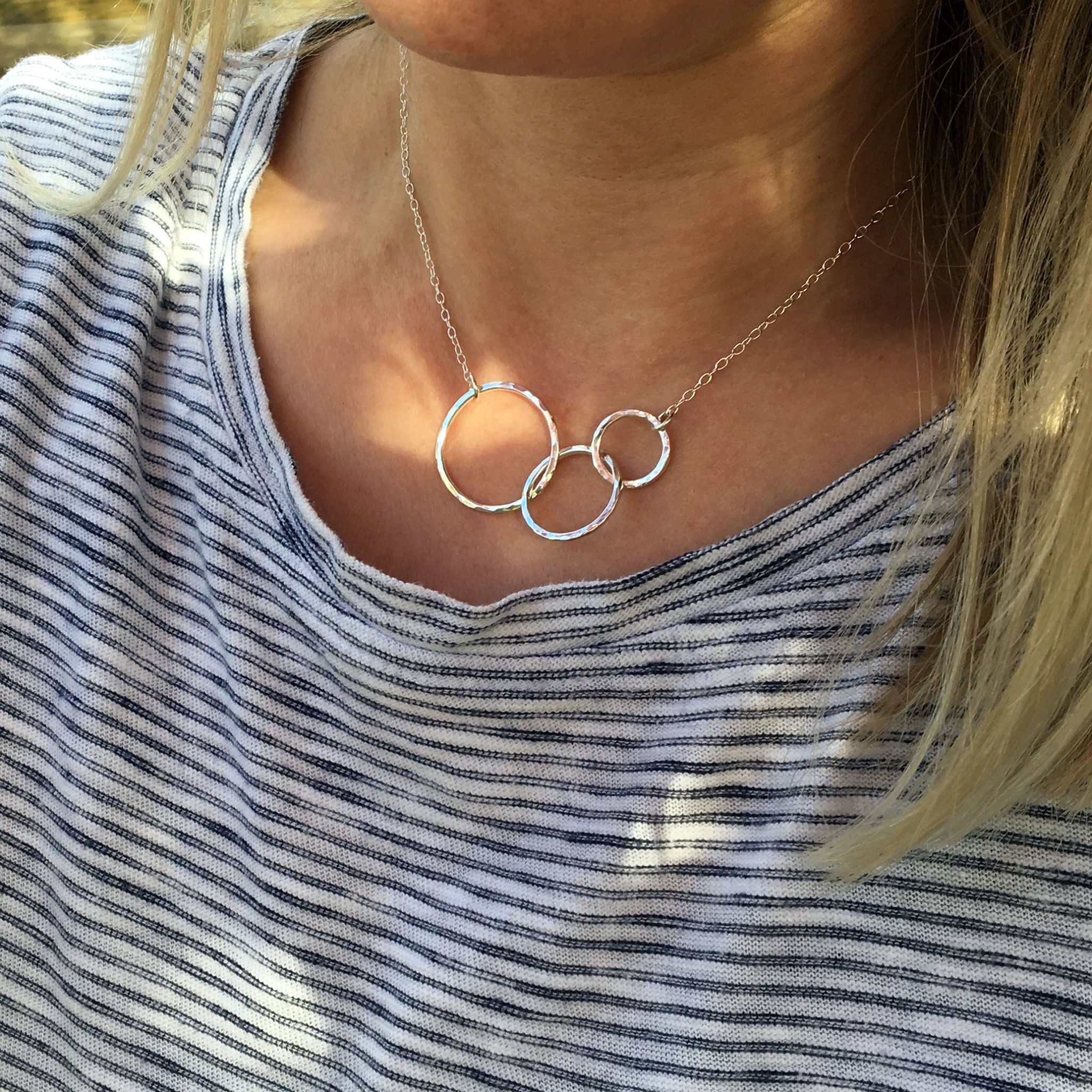 three circles silver necklace on model